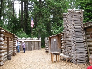Inside the stockade at Fort Clatsop.  Note the tiny windows on either side of the door on the left.  Photo: KGilb.