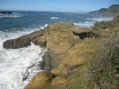 Exterior shot of the Devil's Punch Bowl.  Oregon Coast.  Note the donut hole in the top of the rock.  Photo: KGilb.