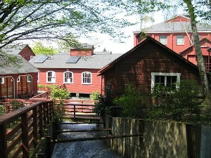 Water still flows down the old mill race, passing directly underneath the dye house.  Thomas Kay Woolen Mill.  Photo: KGilb.