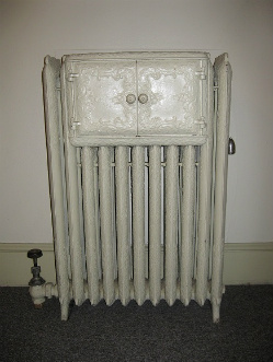 Antique radiator with built-in warming oven. Circa 1900. Photo: KGilb.